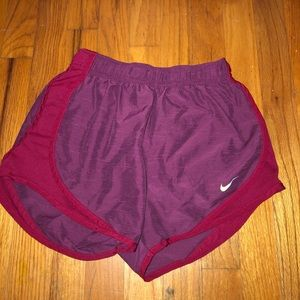 Maroon and red Nike shorts